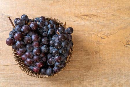 fresh black grapes in basket Archivio Fotografico