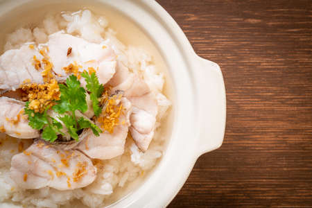 porridge or boiled rice soup with fish bowl Stock Photo