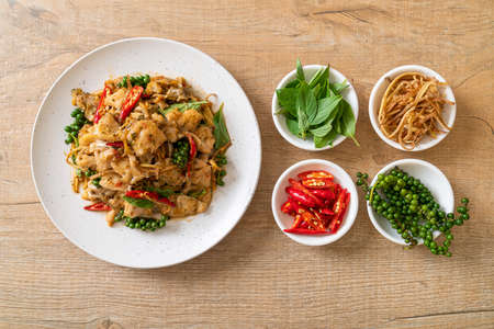 stir fried holy basil with fish and herb - Asian food style