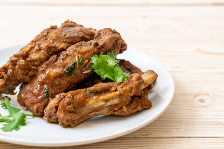 Baked pork ribs with sauce and vegetable Foto de archivo