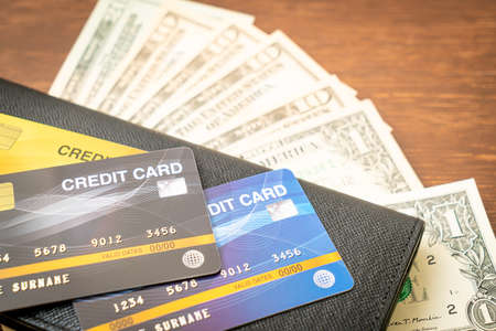 wallet with money and credit card - Economy and finance concept