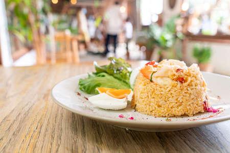 shrimps fried rice with salt egg on plate