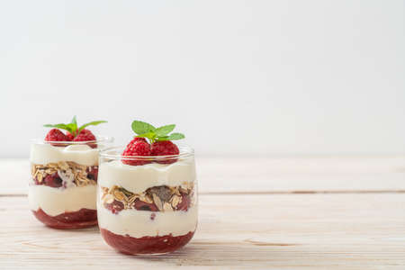 fresh raspberry and yogurt with granola - Healthy food style