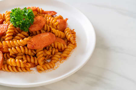 spiral or spirali pasta with tomato sauce and sausage - Italian food style