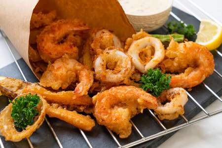 deep fried seafood (shrimps and squid) with mix vegetable - unhealthy food style