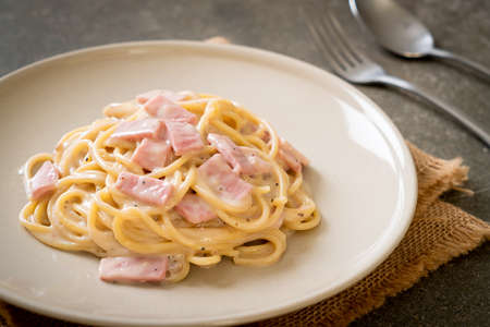 homemade spaghetti white cream sauce with ham - Italian food style