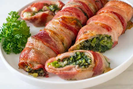 baked bacon roll stuffed spinach and cheese Stock Photo