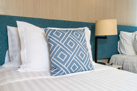 beautiful pillow on bed decoration room interior Stockfoto