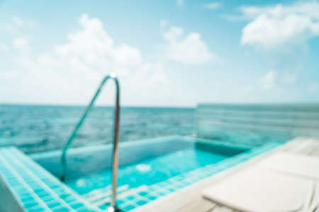 abstract blur and defocused swimming pool and sea background in Maldives