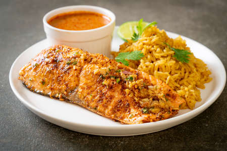 pan seared salmon tandoori with masala rice - muslim food style Reklamní fotografie - 158827861