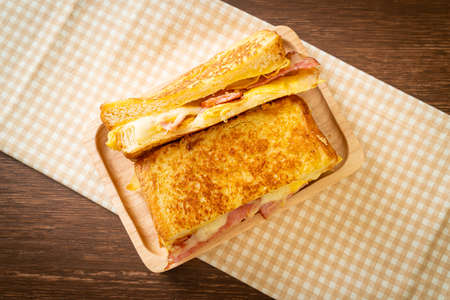 Homemade French toast ham bacon cheese sandwich with egg