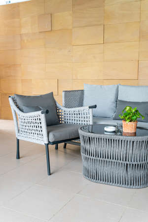 empty outdoor patio chair and table with pillow