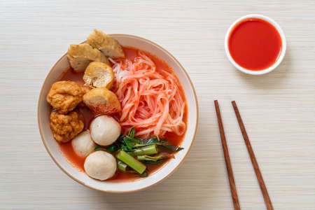 small flat rice noodles with fish balls and shrimp balls in pink soup, Yen Ta Four or Yen Ta Fo - Asian food style