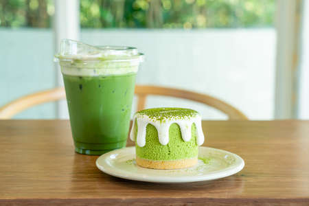 matcha green tea cheese cake with green tea cup on table in cafe restaurant Reklamní fotografie