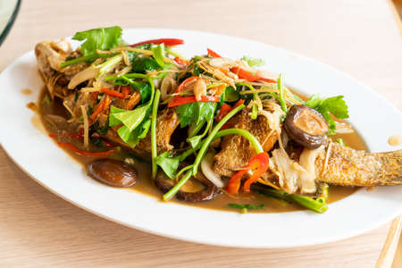 deep fried sea bass fish with sweet sauce and trimmings - Asian food style Foto de archivo