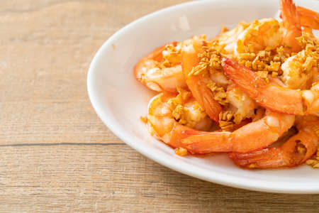 fried shrimps or prawns with garlic on white plate - seafood style Reklamní fotografie