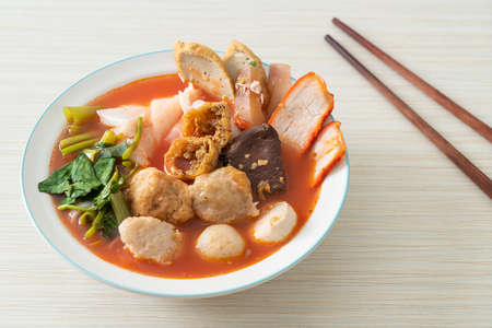 noodles with meatballs in pink soup or Yen Ta Four Noodles in Asian style Reklamní fotografie