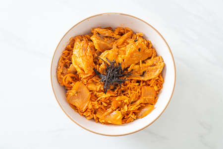 kimchi fried rice with pork sliced - Korean food style
