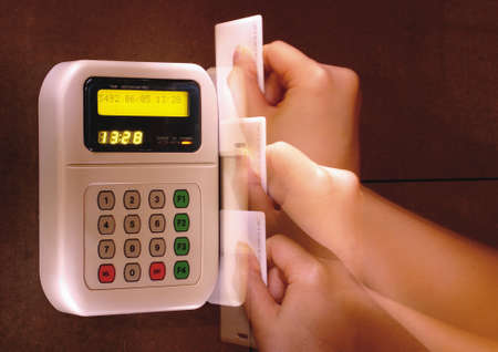 Persons hand swiping a card through a card reader Stock Photo