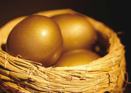 Close-up of golden eggs in a nest