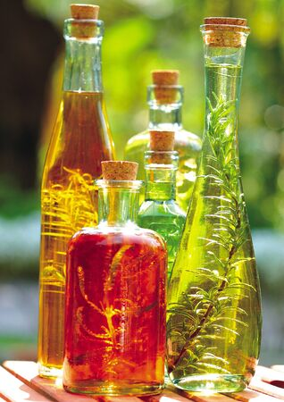 closed corks: Close-up of plants in bottles of oil