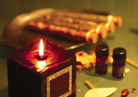 test tube holder: Close-up of a burning candle and aromatic oil with potpourri