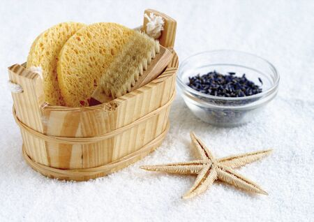 Loofah and scrub in a wooden pail photo