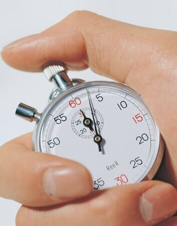Close-up of a stopwatch in a mans hand