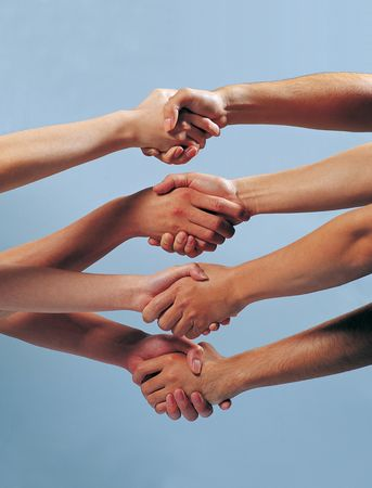 четыре человека: Close-up of four people shaking hands Фото со стока