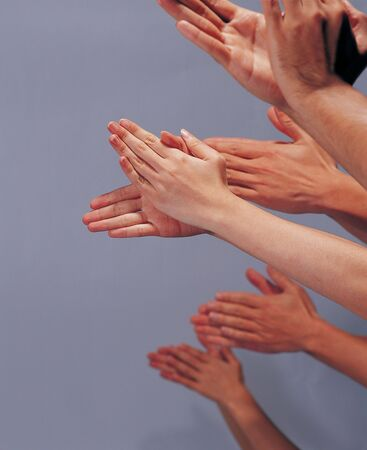 Close-up of hands clapping