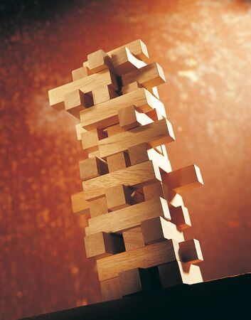 Low angle view of a tower of wooden blocks