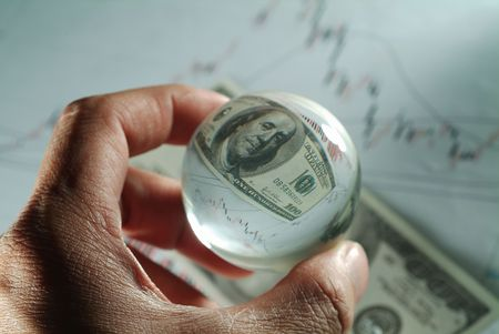 investmen: Close-up of a glass ball in a mans hand