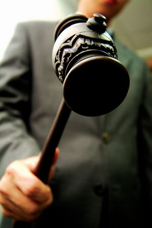 Low angle view of a wooden hammer in a persons hand Stock Photo
