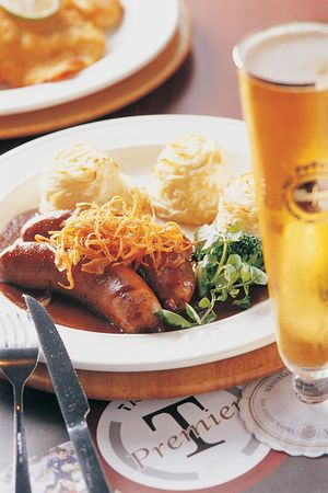 High angle view of sausages and beer Stock Photo