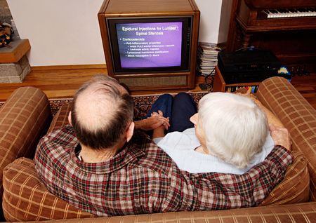 High angle view of an elderly couple watching television Stock Photo