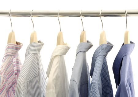 View of shirts displayed on a rod