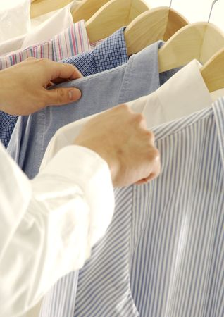 unknown age: Cropped view of a man selecting a shirt Stock Photo