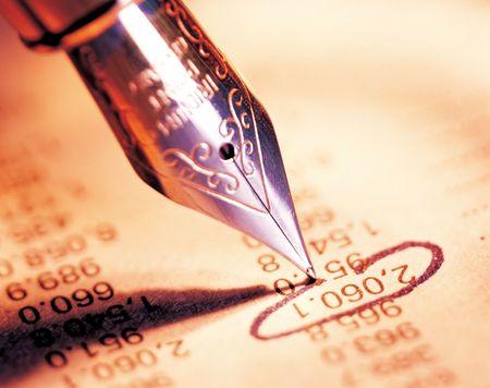 circling: Close-up of an ink pen circling a number Stock Photo