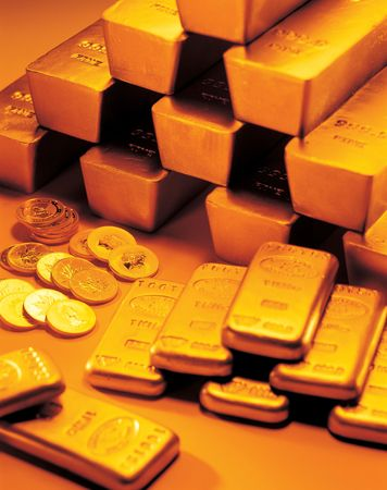 High angle view of gold coins with gold biscuits and bricks