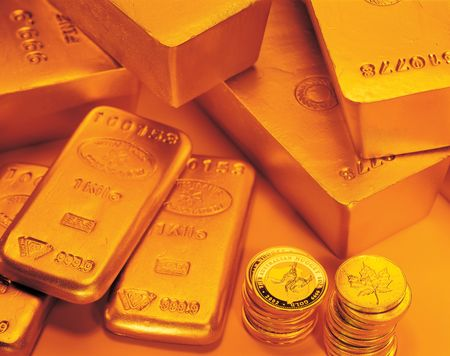kilo: High angle view of gold coins with gold biscuits and bricks