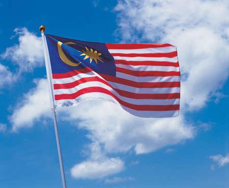 glorification: Low angle view of the Malaysian flag on a pole