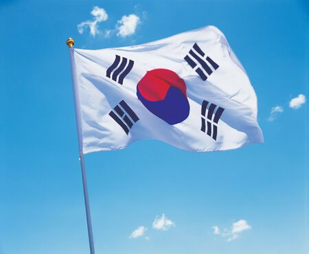 glorification: Low angle view of the South Korean flag on a pole