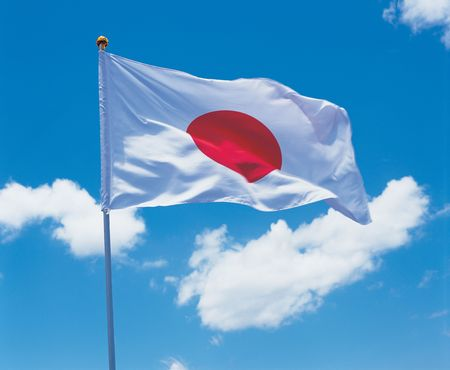 glorification: Low angle view of the Japanese flag on a pole