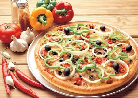 sustenance: High angle view of assorted vegetables and a pizza Stock Photo