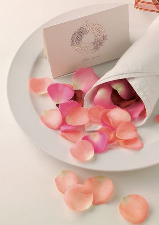 High angle view of rose petals in a napkin on a plate