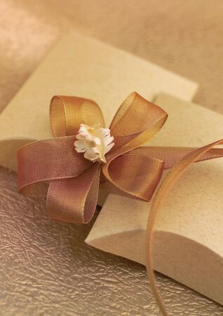 High angle view of a bow on gift boxes photo