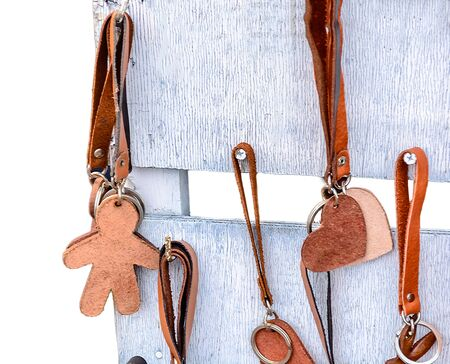 Leather Keychain on wooden background