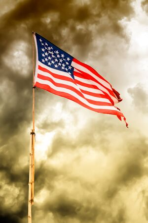 American flag waving on bamboo poles in vintage tone Stock Photo