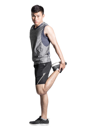 Portrait of a handsome asian man warming up for running. Isolated on white background