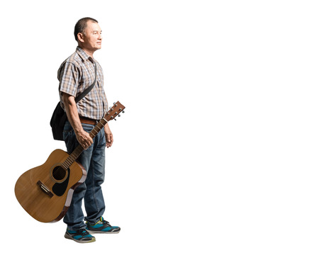 thai musical instrument: Portrait of a happy mature man standing and holding guitar. Isolated full length on white background with copy space